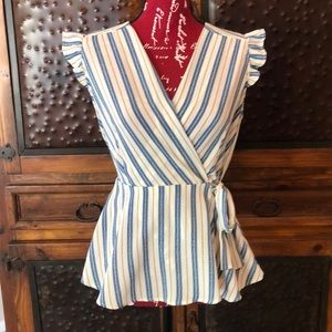 Blouse tie at waist with ruffled cap sleeve.